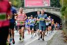 picture of marathon runners coming out of tunnel