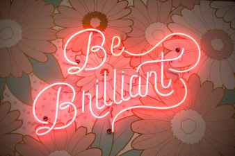 picture of neon lights saying be brilliant