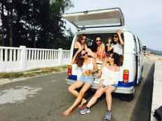 Group of young women in back of a van on road trip